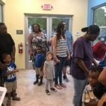 Parents and children enter the CHILD Center, which is open as of August 13, 2018.