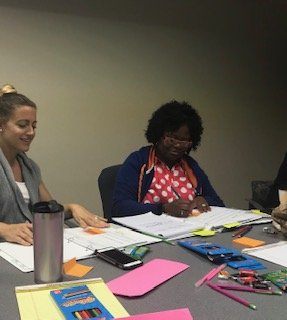 Two CHILD Center staff members work together to develop skills in the Zucker Center's Practice-Based Coaching model