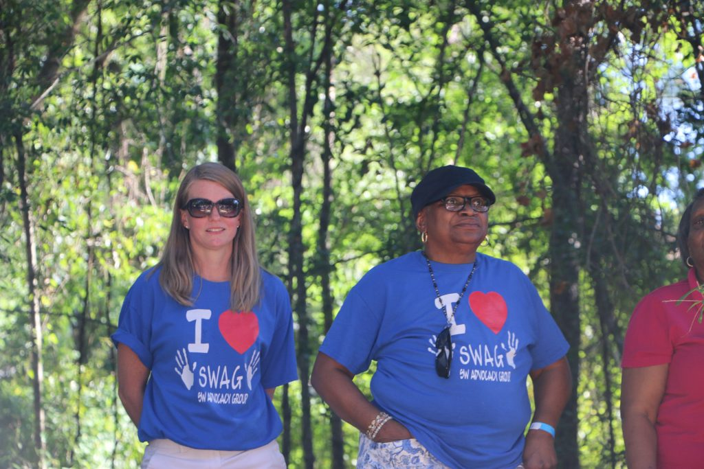 SWAG board members Dorothy Thomas and McLinda Gilchrist stand together celebrating breaking ground for the CHILD Center.