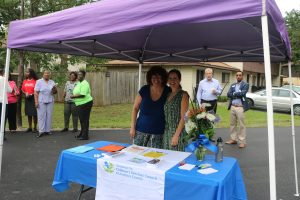 Two women with the Children's Trust of Alachua County smile from an information booth.