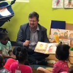 Gainesville mayor Lauren Poe reading a story to CHILD Center kids