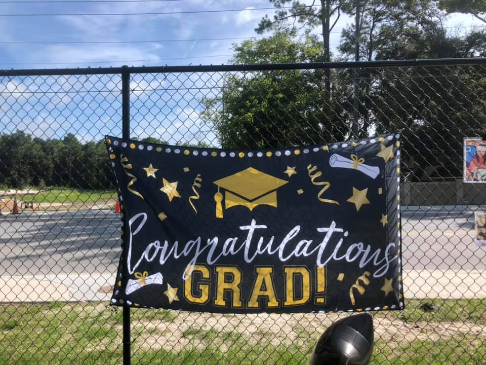 """A hanging sign that reads, """"Congratulations Grad!"""""""