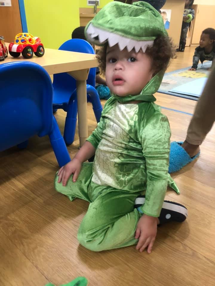 A CHILD Center student wearing a dinosaur costume