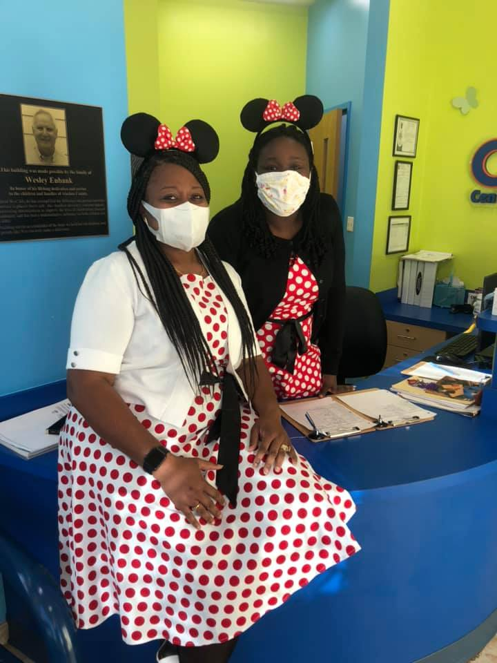 Two CHILD Center staff dressed as Minnie Mouse