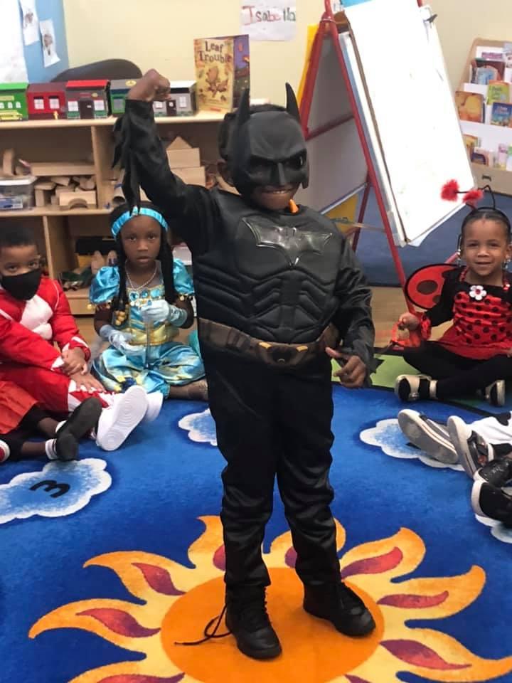 A CHILD Center student wearing a Batman costume
